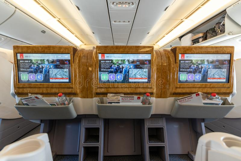 DUBAI, UAE - CIRCA 2019: Emirates airline business class interior. Emirates is the flag carriers of the United Arab Emirates and stock image
