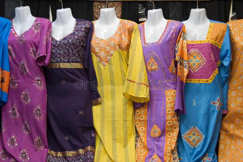 Dubai UAE Colorful women's dresses are displayed for sale at the Al Naif souq in Deira stock photo