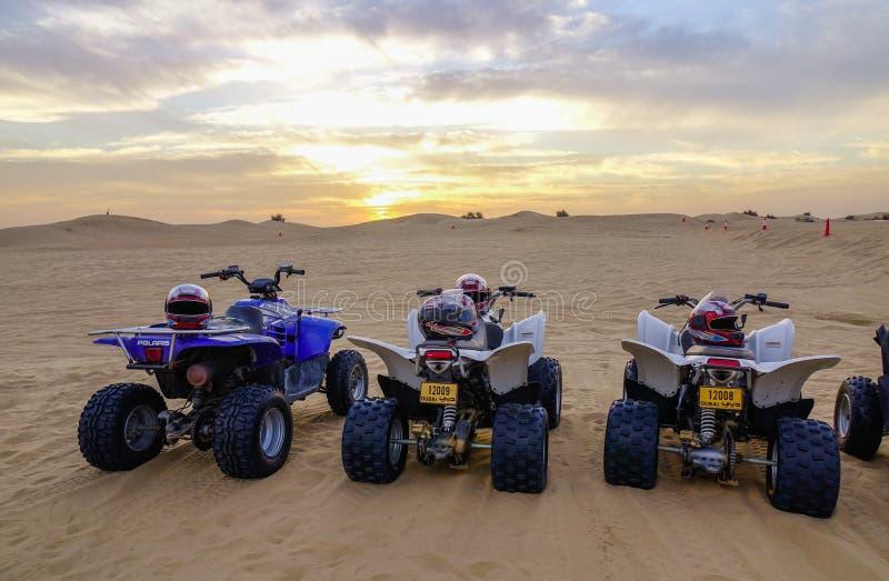 Riding quadbike on the Dubai desert royalty free stock photography
