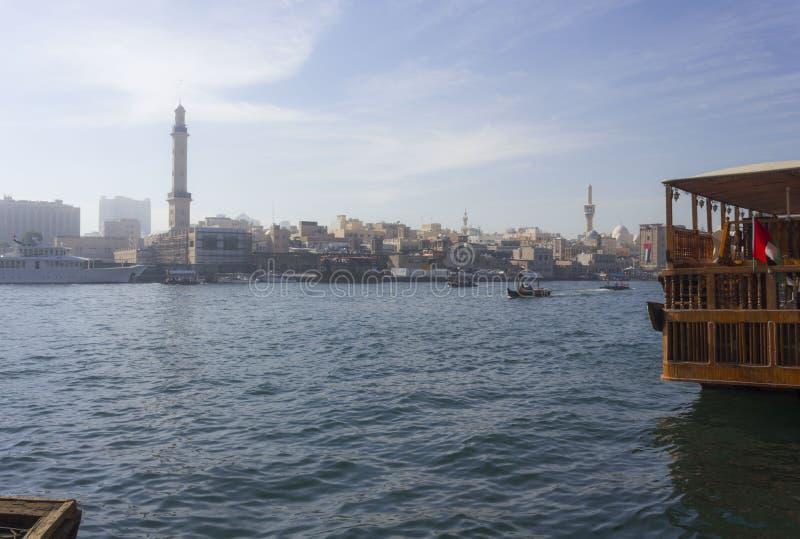 Dubai Creek withtraditional boats navigating royalty free stock photo