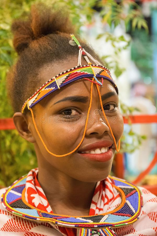 Portrait of an African girl to meet guests in the pavilion Africa of Global Village in Dubai. DUBAI, UAE - DECEMBER 4, 2017: Portrait of an African girl to meet royalty free stock images