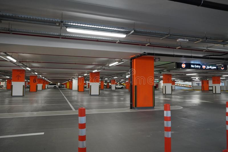 Dubai UAE December 2019 Underground parking which is almost empty. Empty garage in basement of office building. Reinforced. Concrete monolithic floors in stock photography