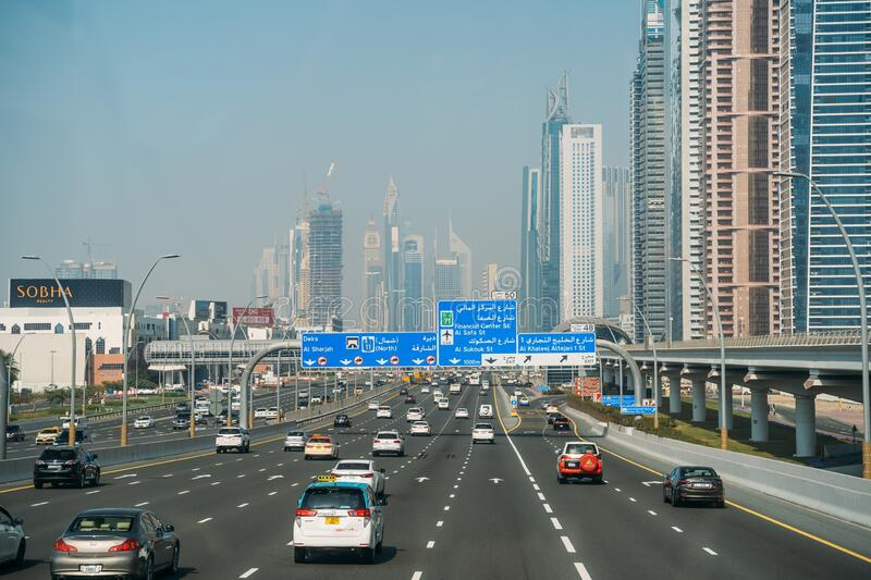 DUBAI, UAE - February 2020: Traffic on Dubai road with many cars. Sheikh Zayed road - famous highway in Dubai royalty free stock image
