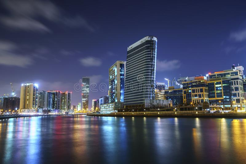 DUBAI,UAE - jANUARY 07,2018: Downtown summer night skyline. Panoramic view of business bay and downtown area of Dubai reflection royalty free stock images