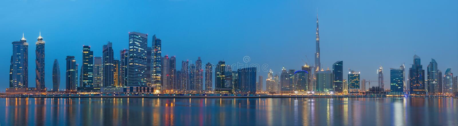 DUBAI, UAE - MARCH 23, 2017: The evening panorama over the new Canal with the Downtown and Burj Khalifa tower stock photo