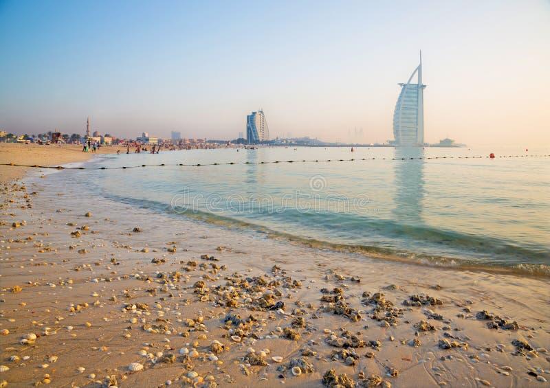 DUBAI, UAE - MARCH 30, 2017: The evening skyline with the Burj al Arab and Jumeirah Beach Hotels and the open Jumeriah beach royalty free stock image