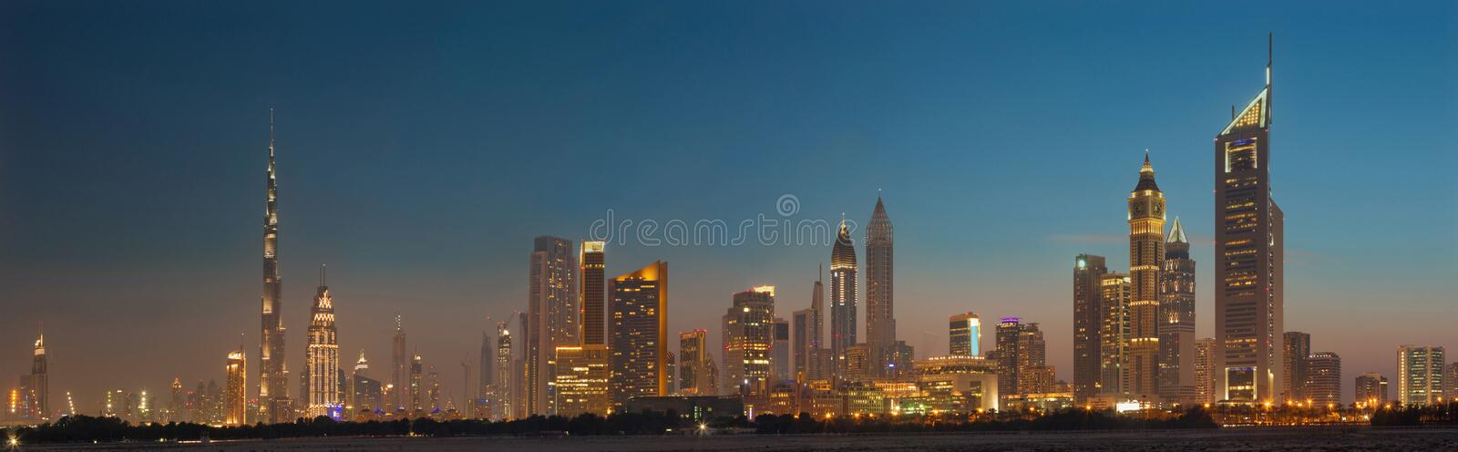 DUBAI, UAE - MARCH 31, 2017: The evening skyline of Downtown with the Burj Khalifa and Emirates Towers.  royalty free stock photography