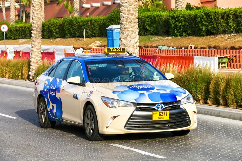 Toyota Camry. Dubai, UAE - November 16, 2018: Hybrid taxi car Toyota Camry in the city street royalty free stock images