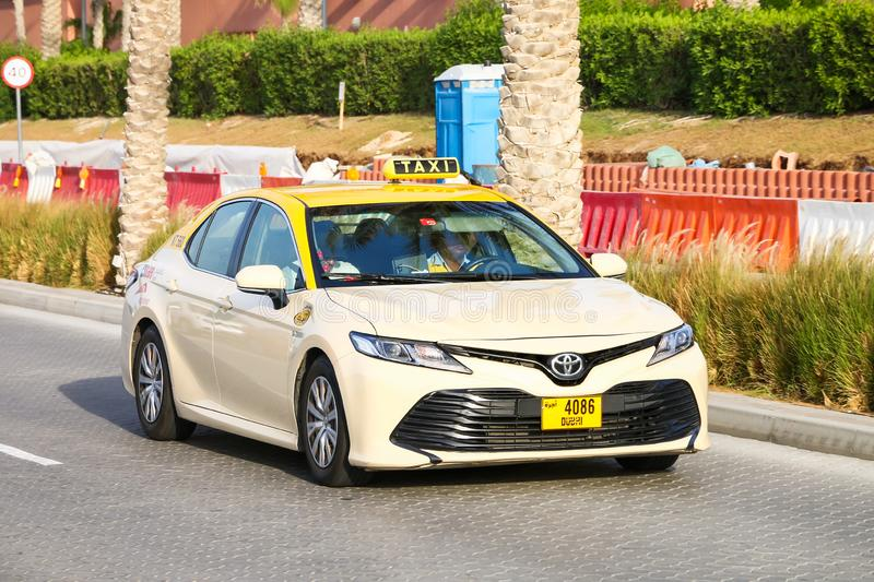 Toyota Camry. Dubai, UAE - November 16, 2018: Taxi car Toyota Camry in the city street royalty free stock photography