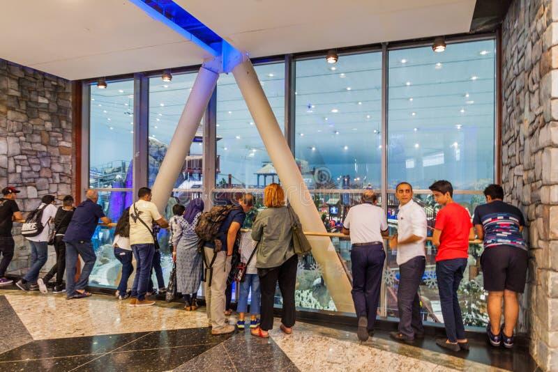 DUBAI, UAE - OCTOBER 21, 2016: People watch Ski Dubai, indoor ski resort in Mall of Emirates shopping mall in Dubai stock photos