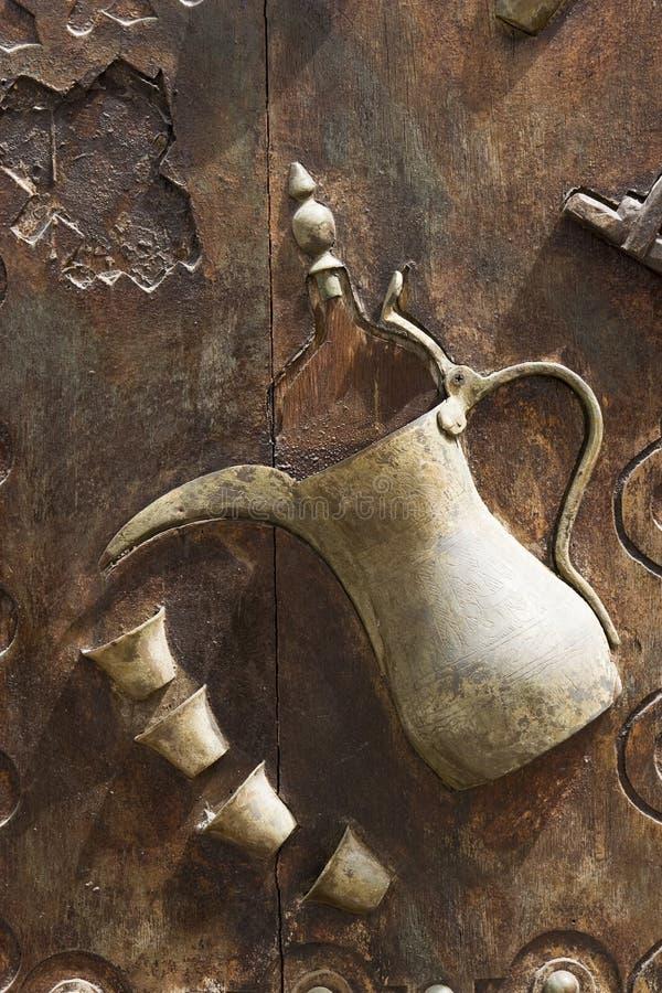 Free Dubai UAE Ornately Decorated Wood Doors At Heritage Village In Bur Dubai Stock Images - 30849434