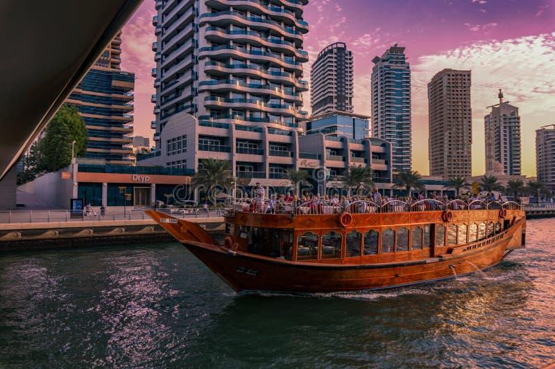 Dubai, UAE / 11. 10. 2018 : Sunset on the Famous traditional wooden old dhow cruise tour in Dubai Marina stock photos