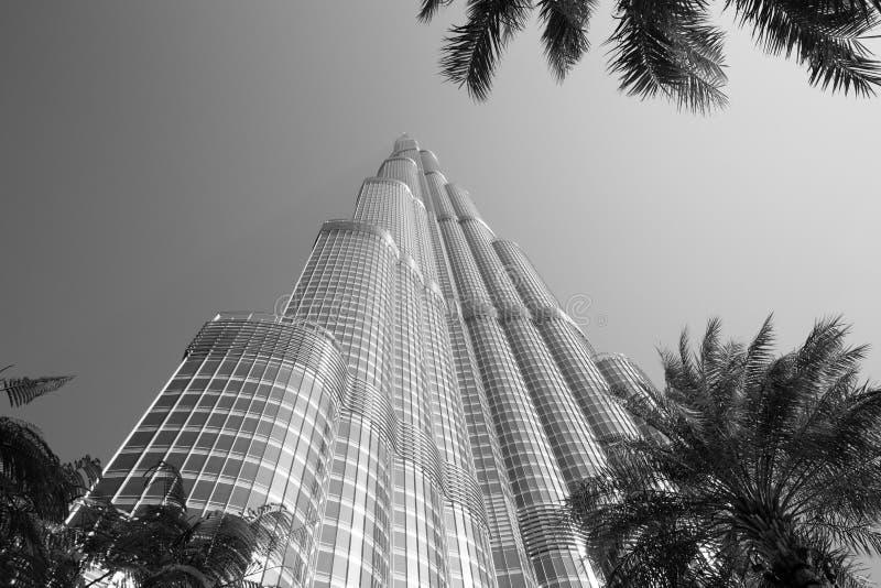 DUBAI, UNITED ARAB EMIRATES – JANUARY 20: Tower Burj Khalifa v. DUBAI, UNITED ARAB EMIRATES – JANUARY 20: Tower Burj Khalifa vanishing in blue sky on royalty free stock photos