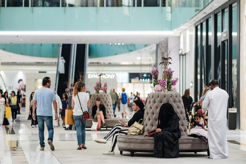 DUBAI, UNITED ARAB EMIRATES - APRIL 25, 2018: Dubai Mall, interior of the shopping center with shops and buyers royalty free stock photos