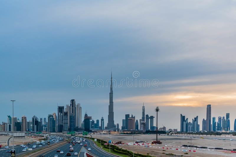Burj Khalifa and Dubai Skyline under Cloudy Sky, Dubai Downtown Residential and Business Skyscrapers, a view from Dubai Canal stock photography