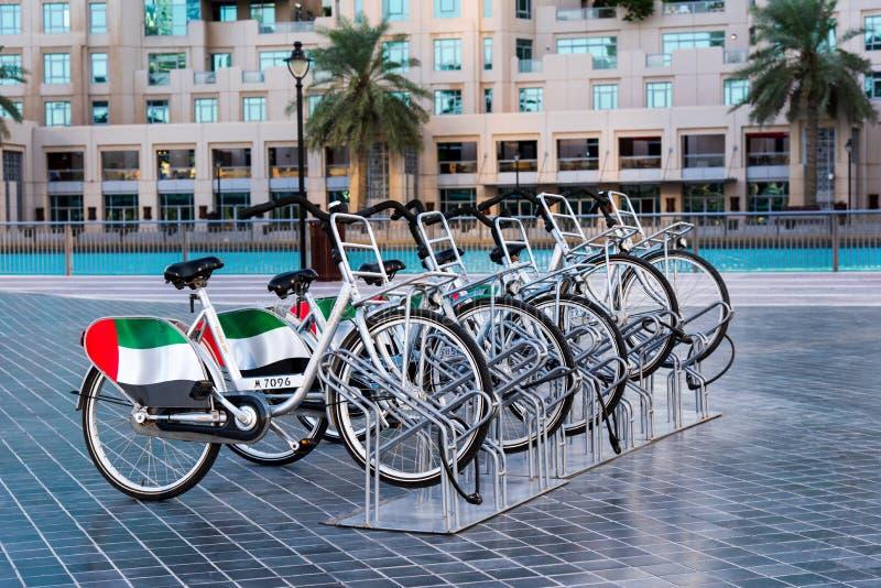Dubai, United Arab Emirates - December 11, 2018: Rental bicycles with UAE flag in Dubai. Dubai, United Arab Emirates - December 11, 2018: Rental bicycles used stock photo
