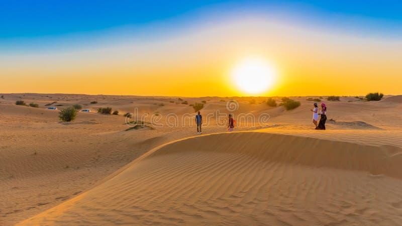 DUBAI, UNITED ARAB EMIRATES - DECEMBER 13, 2018: Sunset over sand dunes in Dubai Desert Conservation Reserve. Copy space for text stock photos
