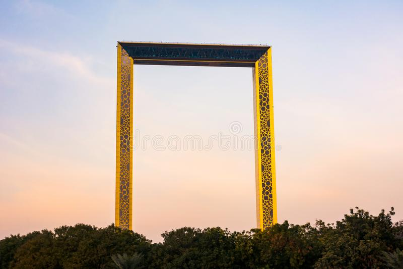 Dubai, United Arab Emirates, February 11, 2018: Dubai Frame building with palm trees at sunset. The frame measures 150 meters high royalty free stock photos