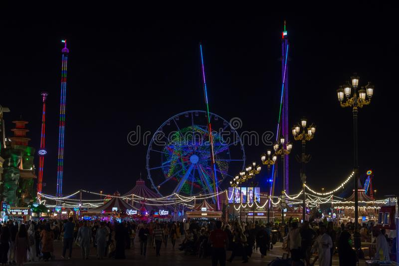 `Dubai, Dubai/United Arab Emirates - 4/9/2019: Global Village tourist attraction in Dubai representing global shops and fun at nig. Ht looking at the amusement stock image