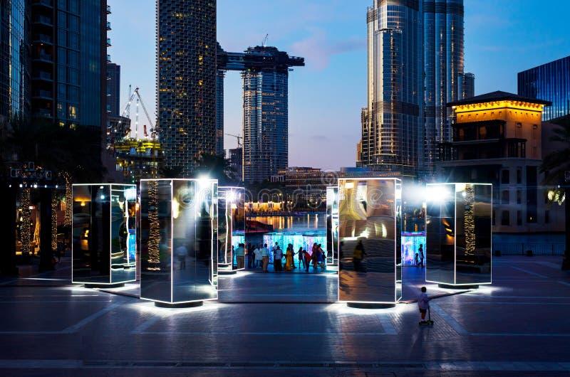 Dubai, United Arab Emirates - January 31, 2018: Spinning mirror and light art installation in Burj plaza of Downtown Dubai stock photo