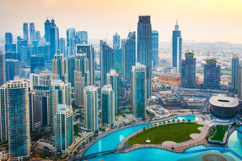 Dubai, United Arab Emirates - July 5, 2019: Dubai downtown skyline and Burj Khalifa Lake at sunset royalty free stock photos