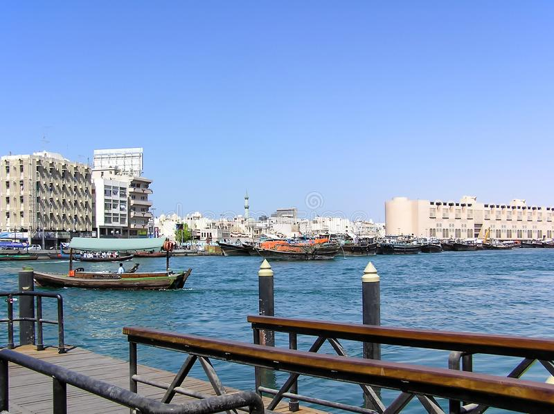 Traditional wooden boats, called Dhow, are moored in Dubai stock photography