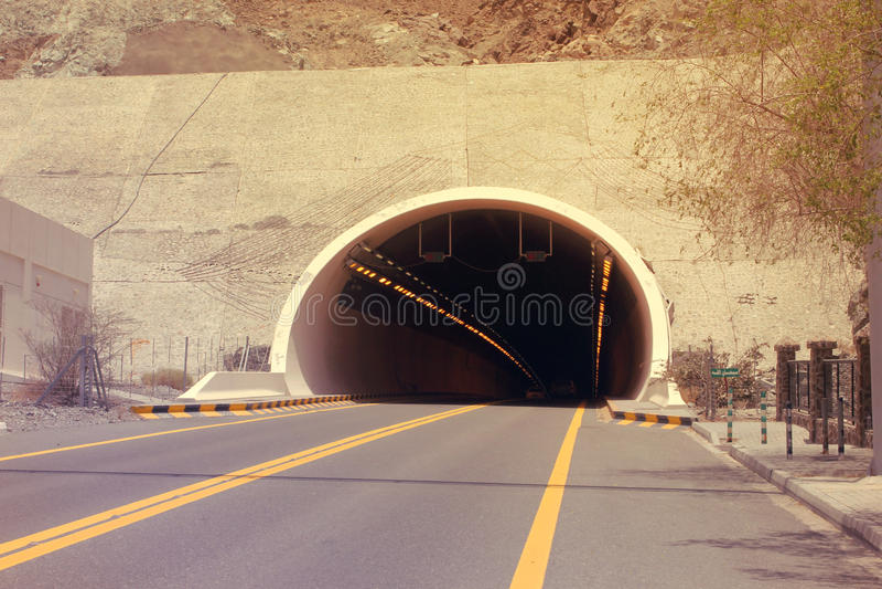 DUBAI-UNITED ARAB EMIRATES ON 21 JUNE 2017. A mountain tunnel on Kalba - Sharjah highway, UAE. Shallow depth of field. DUBAI-UNITED ARAB EMIRATES ON 21 JUNE stock photos