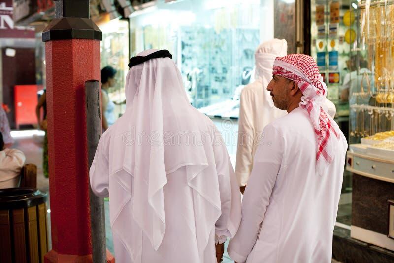 Men wearing Kandura Dubai. Dubai, United Arab Emirates, June 8, 2013: Two men wearing traditional white robes, known as Kandura, Dubai stock images