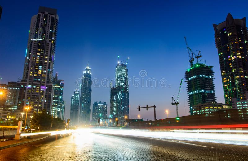 DUBAI, UNITED ARAB EMIRATES - OCTOBER 18, 2017: Traffic in Business bay in Dubai, night scene with light trails royalty free stock photography