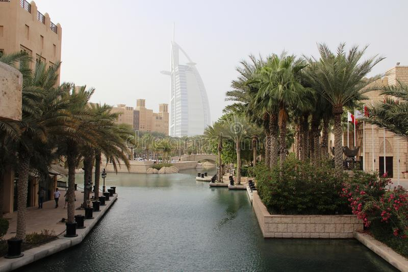Dubai view channels the hotel Parus. Dubai view channels Parus hotel beautiful palm trees water sky attraction tourism travel photography stock photography