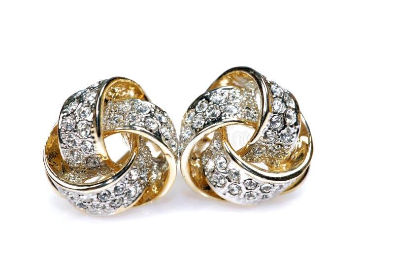 dubbade diamantörhängesmycken arkivbilder