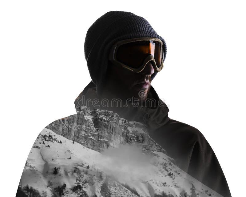 Dubbel blootstellingsportret van de mens in wintersporten kleding en berg royalty-vrije stock foto