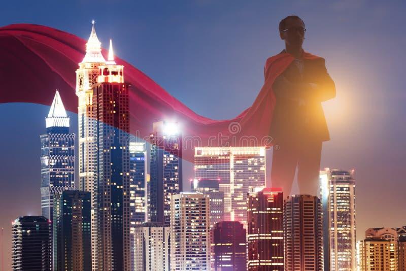 Dubbel exponering av affärsmanSuperhero With Red udde arkivfoto