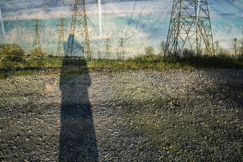 Dubbel exponering av pylonandshadow arkivbilder