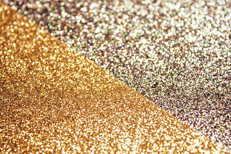 Dubbel guld- skinande bakgrund royaltyfri bild