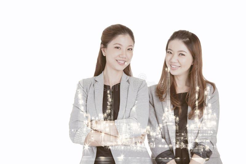 Dubbele blootstelling twee onderneemsters royalty-vrije stock foto