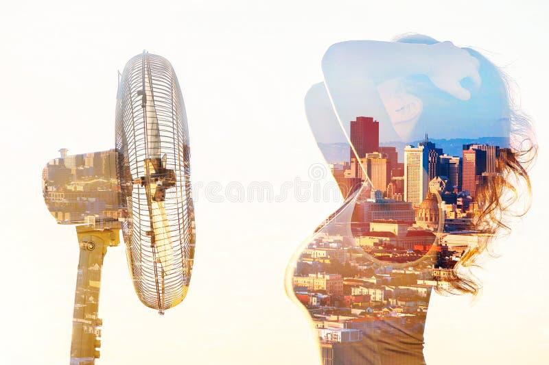 Dubbele blootstelling van een vrouwenlichaam met een ventilator en de stad van San Francisco stock foto