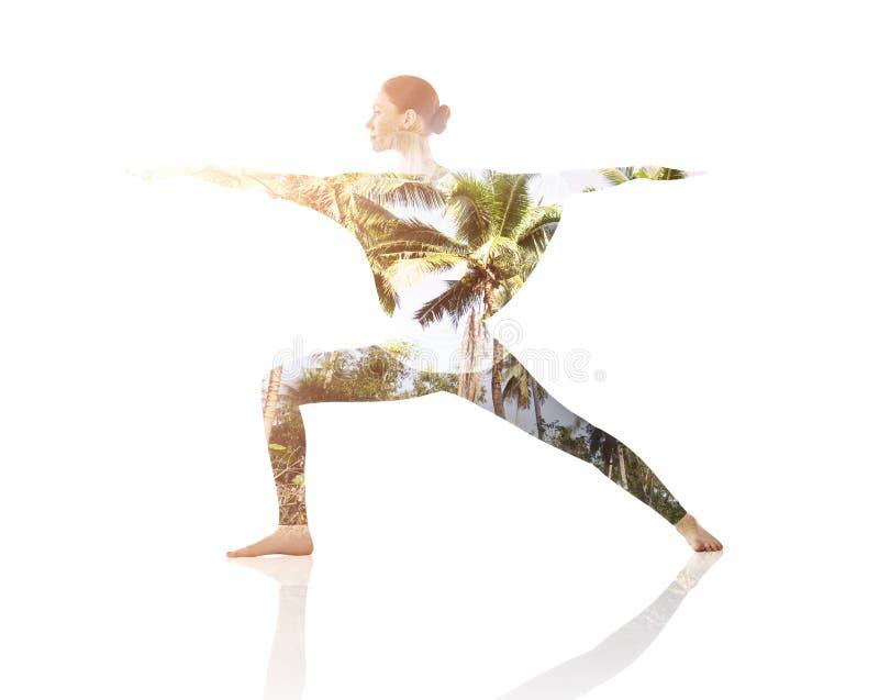 Dubbele blootstelling van vrouw die yogaoefening doen stock fotografie