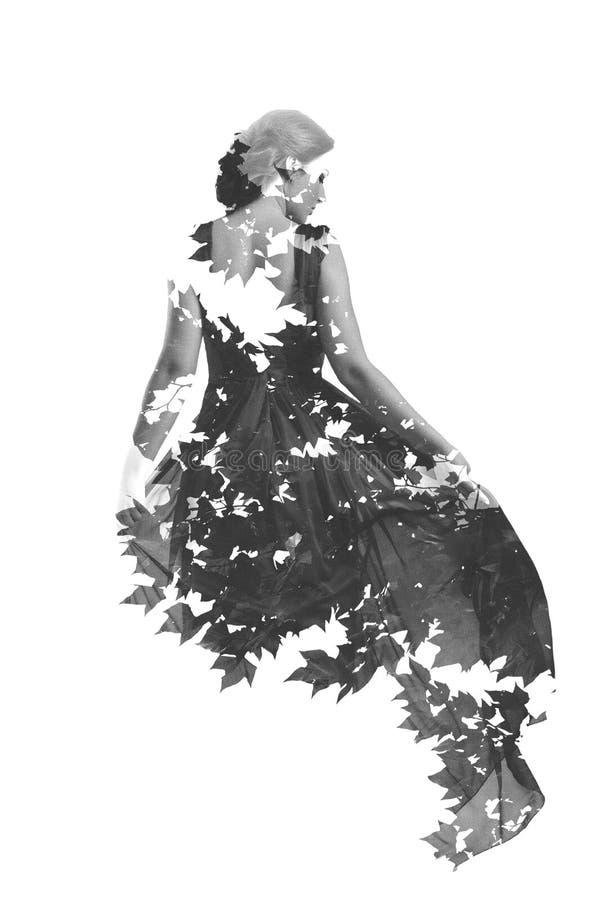 Dubbele blootstelling van vrouw en boom stock foto