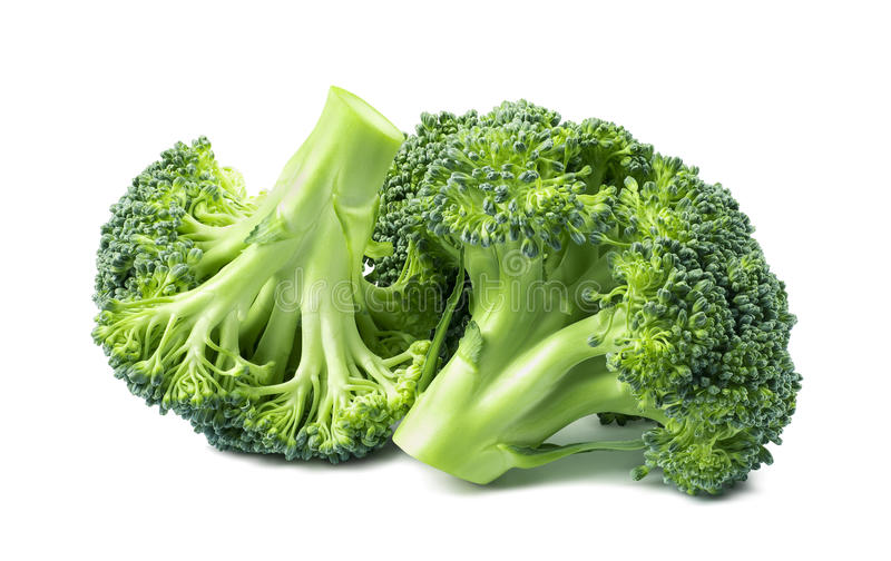 Dubbele die broccoligroep op witte achtergrond wordt geïsoleerd stock foto's