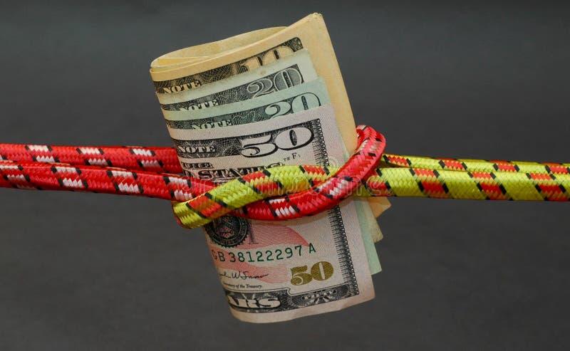 Dubbele platte knoop en geld royalty-vrije stock afbeeldingen