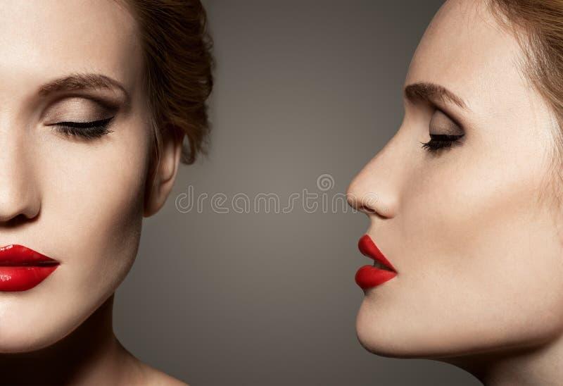 Dubblett beskådar ståenden av den härliga kvinnan med ljust smink fotografering för bildbyråer