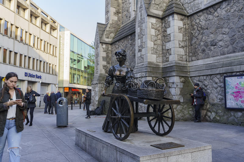 Dublin downtown street view with Molly Malone Statue royalty free stock photos