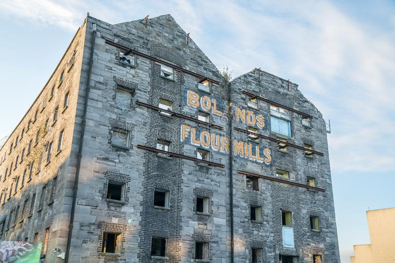 Old building shell, Bolands Flour Mills, Dublin. DUBLIN, IRELAND - AUGUST 9, 2017; Old building shell with original industrial signage, Bolands Flour Mills, in stock photo