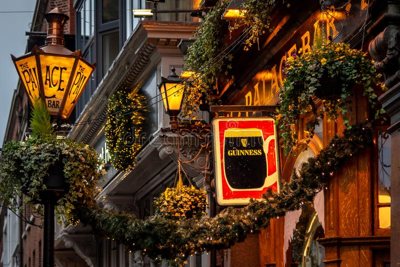 DUBLIN, IRELAND, DECEMBER 24, 2018: Close up of the exterior of the Palace Bar, decorated for Christmas on Fleet Street, with a. Street lamp with its name royalty free stock photo
