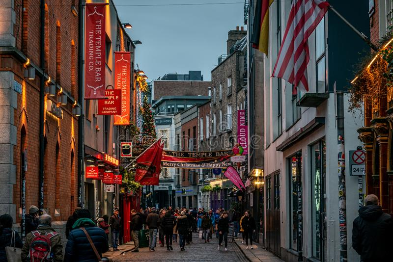 DUBLIN, IRELAND, DECEMBER 24, 2018: People walking in Temple Bar in christmas time. Historic district, a cultural quarter with. DUBLIN, IRELAND, DECEMBER 24 stock images
