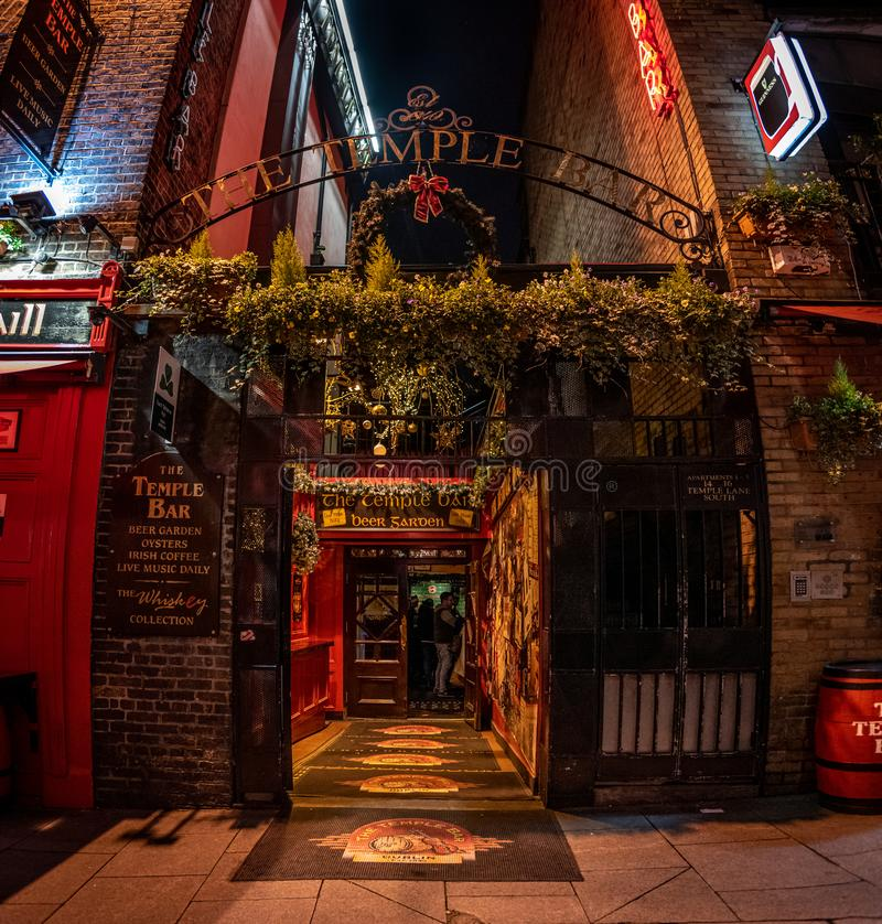 DUBLIN, IRELAND, DECEMBER 24, 2018: Temple Bar historic district, known as cultural quarter with lively nightlife. Nightscene of. The bar, full of neon lights royalty free stock photos