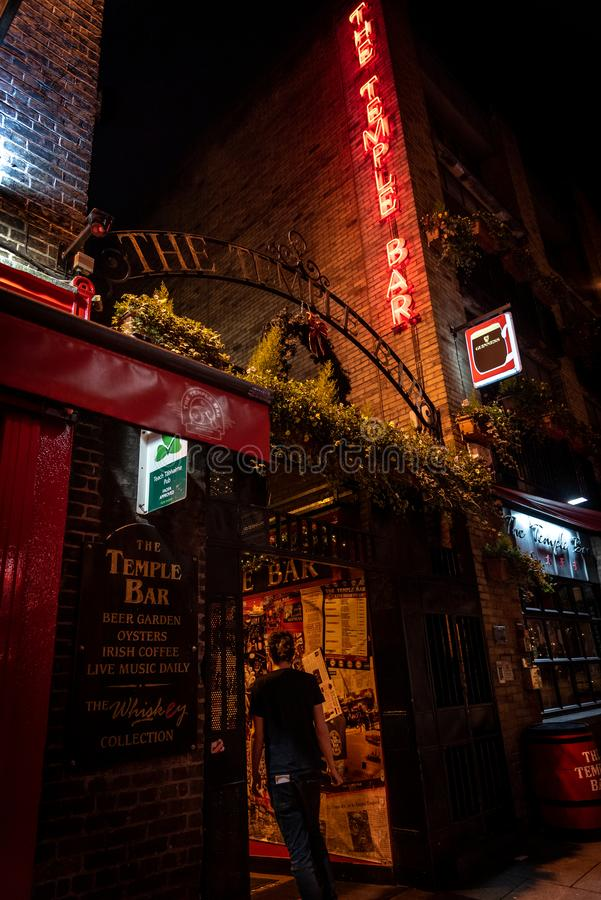 DUBLIN, IRELAND, DECEMBER 24, 2018: Temple Bar historic district, known as cultural quarter with lively nightlife. Nightscene of. The bar, full of neon lights stock photo