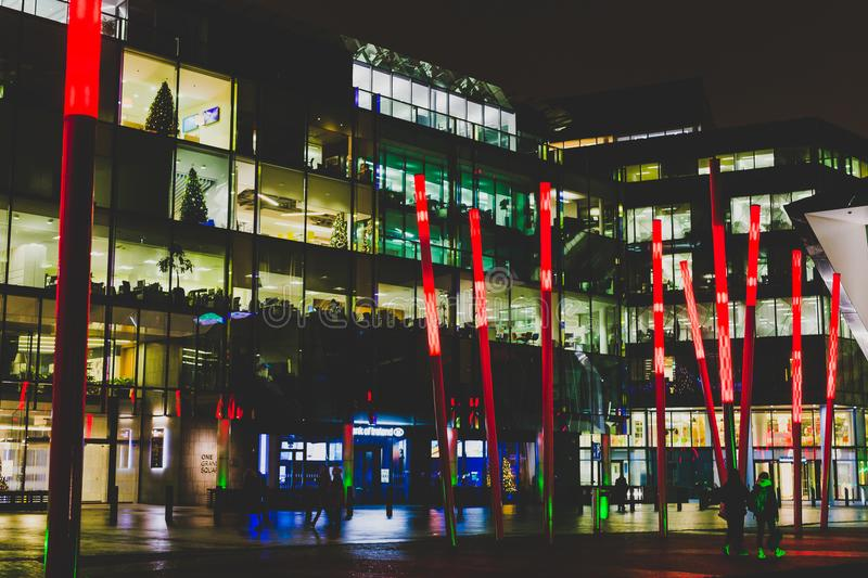 Grand Canal Square by night in the renovated Docklands area. DUBLIN, IRELAND - December 20th, 2017: Grand Canal Square by night in the renovated Docklands area royalty free stock photography