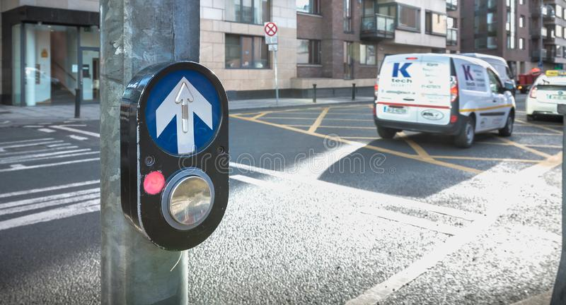 Button to activate pedestrian crossing on the road in Dublin stock photo
